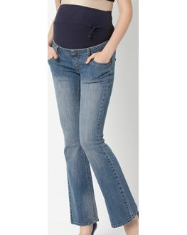 Boot legged maternity denim with stratchable waist band for baby-bump support, large, light blue stone washed